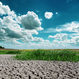 Dramatic sky over drought earth Stock Image