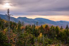 Forested Mountain landscape at dusk, Stunning fall colors.