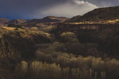 Dramatic Sky Over S.O.B. Canyon. Dramatic sky over the giant 175-foot 53-meter gorge named S.O.B. Canyon, near Clarkdale, Arizona royalty free stock images
