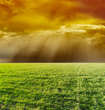 Dramatic sky over green field Royalty Free Stock Images