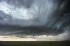 Rotating wall cloud of a supercell thunderstorm over the high plains of eastern Colorado stock photo