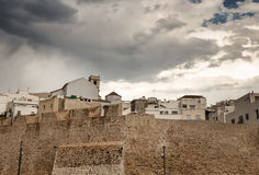 Dramatic sky over the houses of Peniscola, Spain. Dramatic sky over the houses of Peniscola, touristic town in the province of Castellon, Valencian Community royalty free stock photo