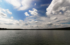 Dramatic sky over the lake Royalty Free Stock Photos