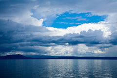 Dramatic sky over lake stock photography