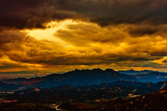 Dramatic sky over mountain Stock Photo