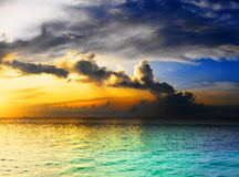 Dramatic sky over ocean. Dramatic sunset sky with clouds over ocean stock photo