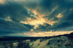 Dramatic sky over Parnidis dune Stock Images