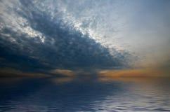 Dramatic sky over quiet and calm sea. Stock Photos