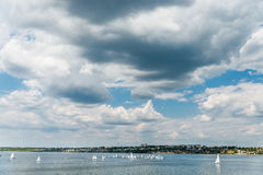Dramatic sky over river with little yachts Royalty Free Stock Photo