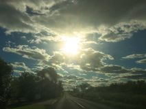 The dramatic sky over the road. A Cotswold road Royalty Free Stock Images