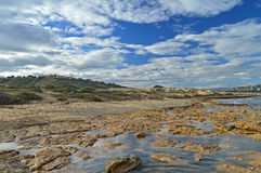 A Dramatic Sky Over Rock Pools Stock Image