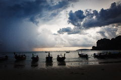 Dramatic sky over the rocky beach. A beautiful rocky beach in asia. Thailand Stock Photos