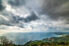 Dramatic sky over Sardinia west coast Stock Photos