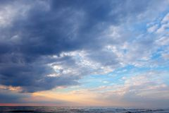 Dramatic sky over the sea with dark, stormy clouds. royalty free stock images
