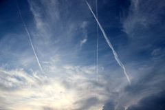 Dramatic sky with planes Stock Photos
