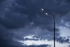 Dramatic sky after rain. The sky, storm clouds and a street lamps. stock images