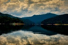 Sky reflected in a lake in Malaysia royalty free stock images