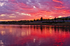 Dramatic sky reflection. In the river at sunset royalty free stock image