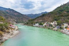 Dramatic sky at Rishikesh, holy town and travel destination in India. Colorful sky and clouds reflecting over the Ganges River. Dramatic sky at Rishikesh, holy Stock Photos