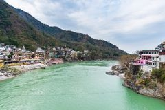 Dramatic sky at Rishikesh, holy town and travel destination in India. Colorful sky and clouds reflecting over the Ganges River. Dramatic sky at Rishikesh, holy Stock Photography