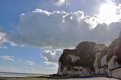Dramatic sky sea scene in Saint Margaret`s bay in Kent. A very dramatiloudy sky in a sea scene in Saint Margaret`s bay Kent England with a large cliff covered in stock images