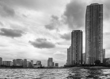 Dramatic sky on the skyscrapers of downtown Tokyo, Japan, seen from the Sumida River royalty free stock image