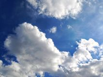 Dramatic sky in spring with fluffy white clouds. Background texture royalty free stock photo