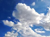 Dramatic sky in spring with fluffy white clouds. Background texture stock images