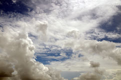 Dramatic sky. Between storms, thick fluffy white clouds floating in a bright blue sky made a dramatic skyscape Stock Image
