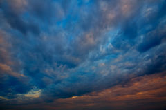 Dramatic sky with stormy clouds in sunset. Sunrise royalty free stock images