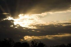 Dramatic Sky Sun Rays. Rays of sun bursting through storm clouds of dramatic sky Stock Photo
