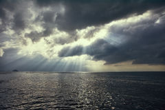 Dramatic sky with sun rays over the sea Royalty Free Stock Photography