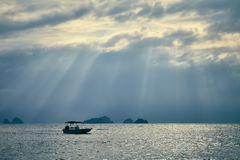 Dramatic sky with sun rays over the sea Stock Photo