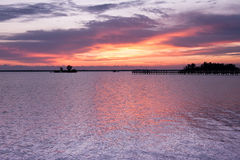 Dramatic sky before sunrise. In lilaceous colors on Indian river, Florida, USA Royalty Free Stock Photography
