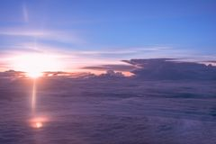 Dramatic sky with sunrise. Over clouds : View from airplane window Royalty Free Stock Photos