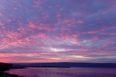 Dramatic sky during sunset. At sea royalty free stock photos