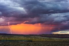 Dramatic sky with sunset and lightning Stock Images