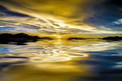 Dramatic sky and sunset reflection on water. For backgorund stock photo