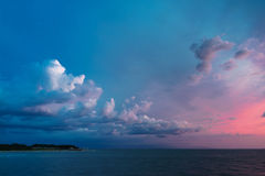 Dramatic sky after sunset. On the sea of Japan Stock Image