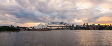 Dramatic sky and the Sydney Opera House. Sydney, Australia - July 11, 2010 : Dramatic sky and the Sydney Opera House at dusk. Sydney skyline taken from Mrs royalty free stock images