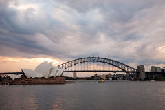 Dramatic sky and the Sydney Opera House. Sydney, Australia - July 11, 2010 : Dramatic sky and the Sydney Opera House at dusk. Sydney skyline taken from Mrs stock photo