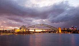 Dramatic sky and the Sydney Opera House. Sydney, Australia - July 11, 2010 : Dramatic sky and the Sydney Opera House at dusk. Sydney skyline taken from Mrs stock image