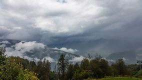 Dramatic sky with thunderclouds and fog over the valley of the river Mzymta, Krasnodar region, Russia.  royalty free stock photos