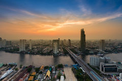 Dramatic sky during twilight over Bangkok river cross city downtown Royalty Free Stock Photography