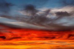 Dramatic sky, vibrant cloud formation at sunset Stock Photos