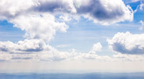 Dramatic sky view, misty mountain landscape below. Royalty Free Stock Image