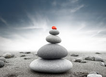 Dramatic spiritual background of zen-like stone pyramid. Tranquil and calm concept Stock Photography