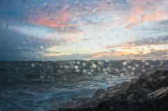 Dramatic splashing ocean wave in the evening with twilight sky in Winter at breakwater at St Kilda pier in Melbourne Australia stock photos