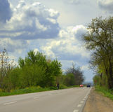 Dramatic spring sky and road Stock Image