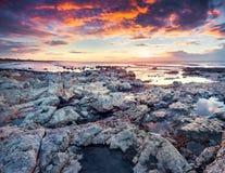 Dramatic spring sunrise on the Passero cape Stock Images